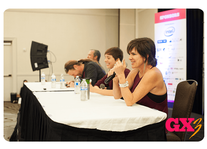 People speaking at a panel