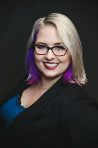 Katie Kaitchuck, a woman with blonde hair and glasses.